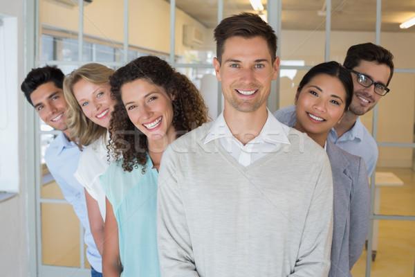 Casual equipo de negocios sonriendo cámara junto oficina Foto stock © wavebreak_media