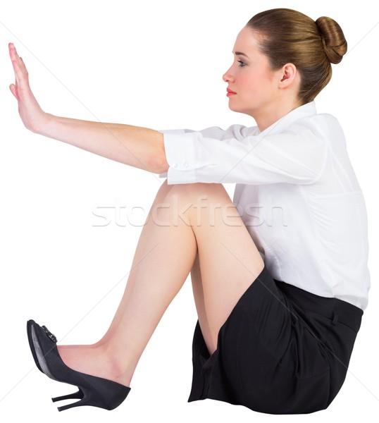 Kobieta interesu posiedzenia piętrze popychanie biały korporacyjnych Zdjęcia stock © wavebreak_media
