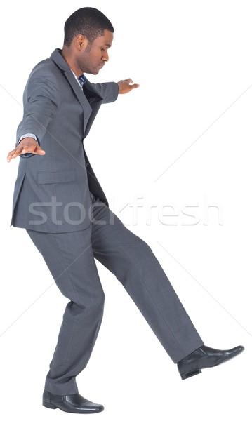 Zakenman balancing handelen witte lopen Stockfoto © wavebreak_media