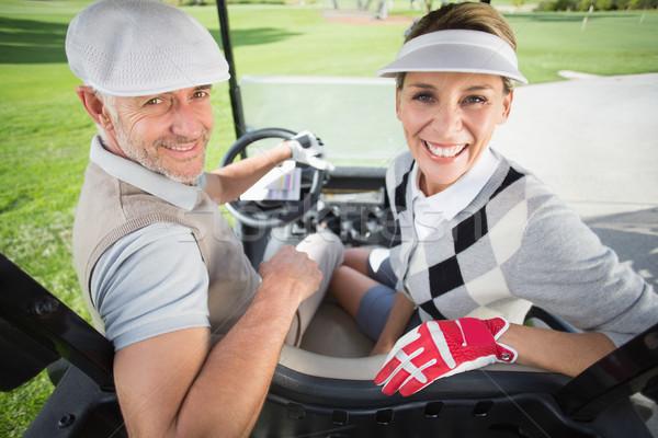 Golfozás pár mosolyog kamera golf napos idő Stock fotó © wavebreak_media