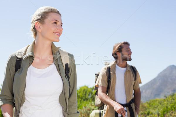 Attractive hiking couple walking on mountain trail Stock photo © wavebreak_media