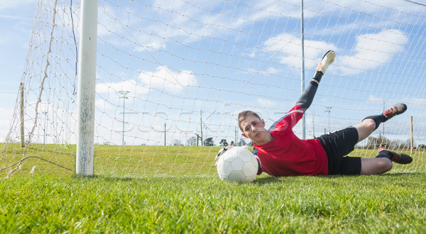 Doelverdediger Rood opslaan gras sport Stockfoto © wavebreak_media