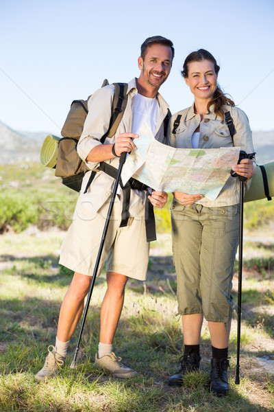 Hiking couple consulting the map in the countryside Stock photo © wavebreak_media