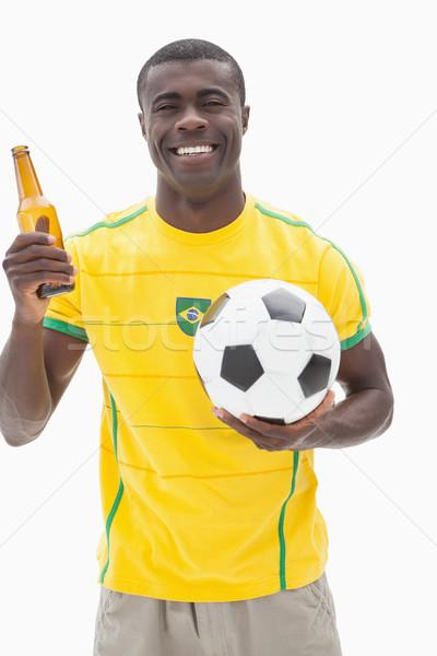 Szczęśliwy piłka nożna fan żółty piwa Zdjęcia stock © wavebreak_media
