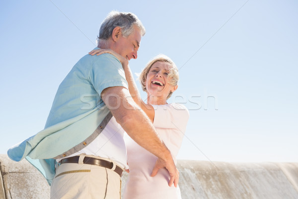 Senior woman hugging her partner Stock photo © wavebreak_media