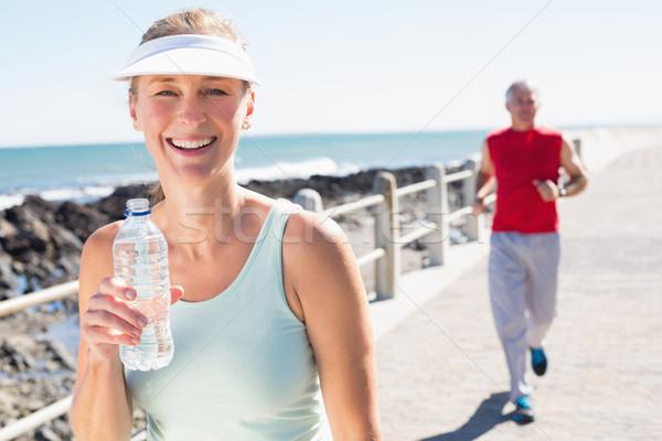 Dopasować dojrzały para jogging wraz molo Zdjęcia stock © wavebreak_media