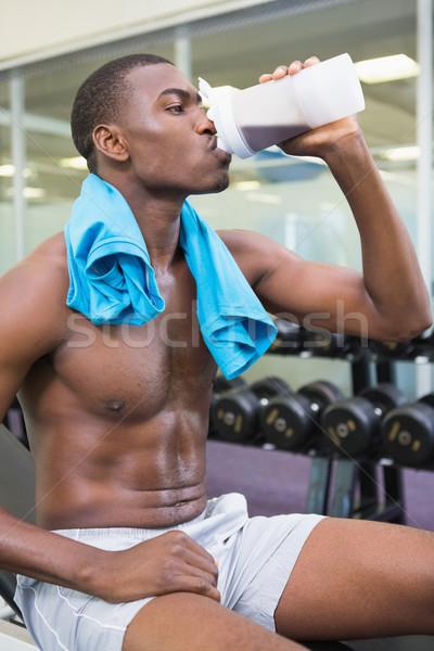 Adam içme protein spor salonu yandan görünüş Stok fotoğraf © wavebreak_media