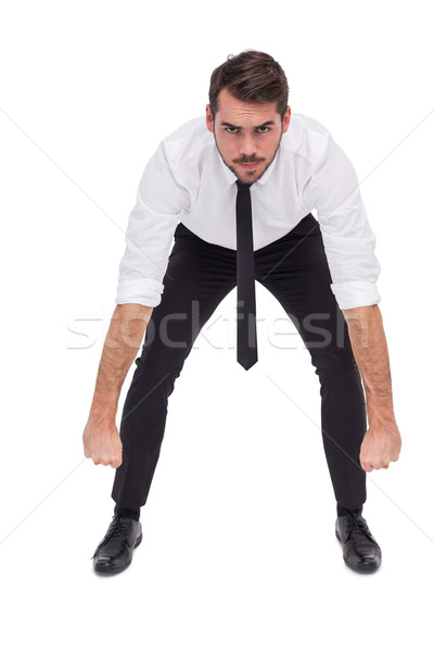 Elegant businessman lifting up something heavy Stock photo © wavebreak_media