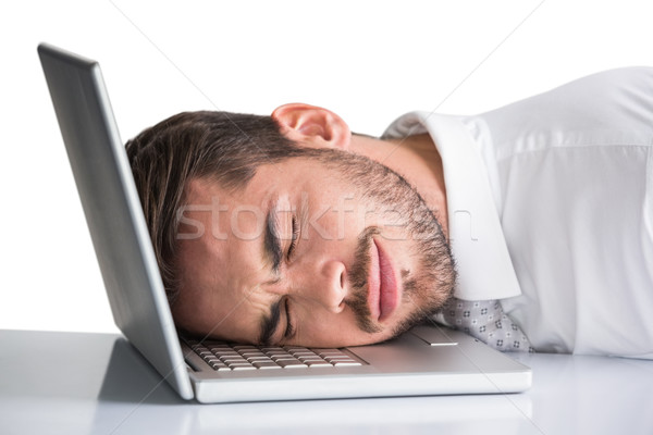 Cheerful businessman resting head on his laptop Stock photo © wavebreak_media