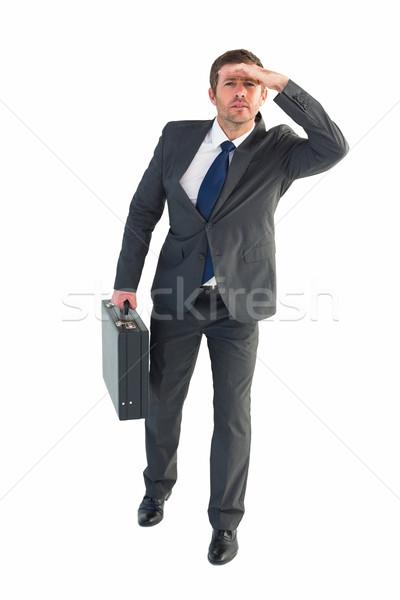 Işadamı bakıyor evrak çantası beyaz adam kurumsal Stok fotoğraf © wavebreak_media