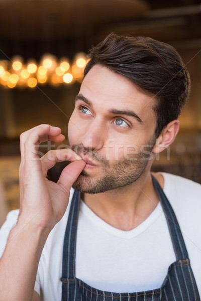 Bonito garçom saboroso gesto café Foto stock © wavebreak_media