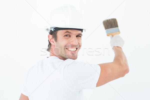 Portrait of happy man using paintbrush Stock photo © wavebreak_media