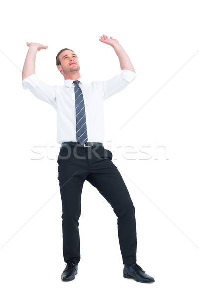 Businessman bending and pushing Stock photo © wavebreak_media