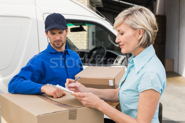 Stock photo:  Happy delivery man with customer