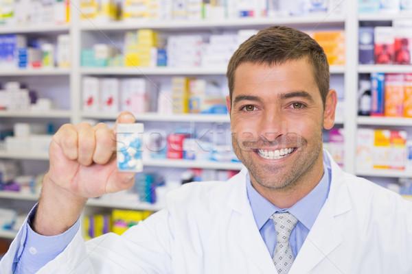 Guapo farmacéutico medicina jar hospital Foto stock © wavebreak_media