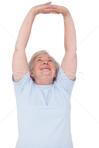 Senior woman stretching her arms Stock photo © wavebreak_media