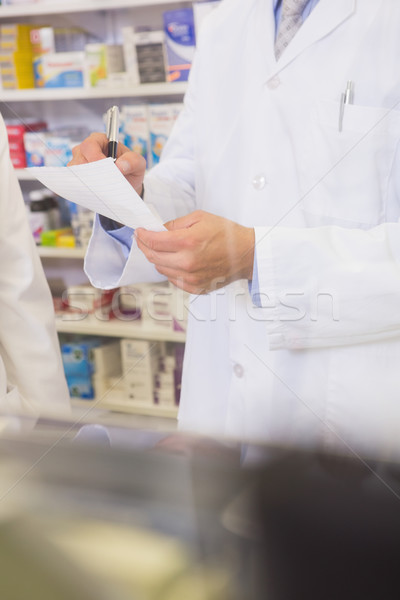 Mid section of pharmacist writing a prescription Stock photo © wavebreak_media
