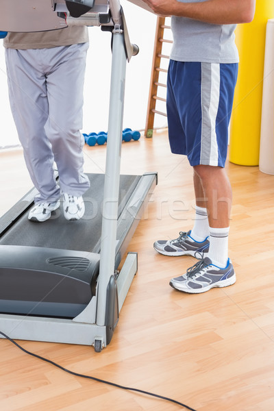 Senior man on treadmill with trainer  Stock photo © wavebreak_media