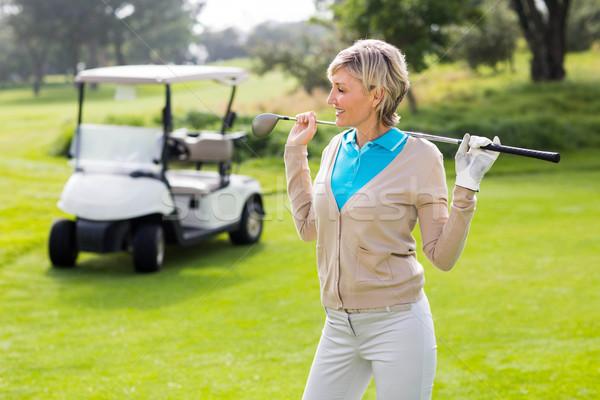 Alegre jogador de golfe em pé verde campo de golfe Foto stock © wavebreak_media