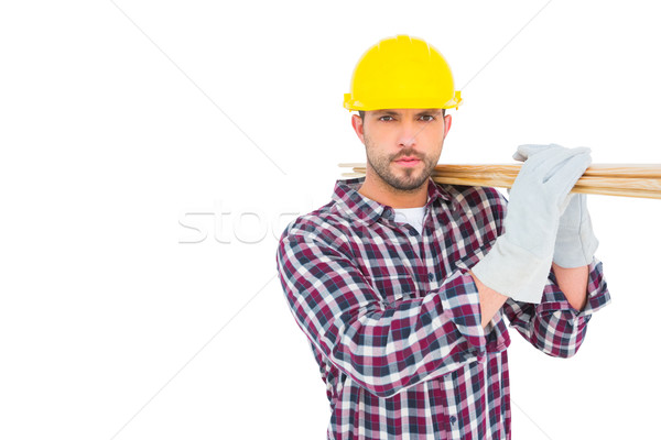 Stock photo: Handyman holding wood planks