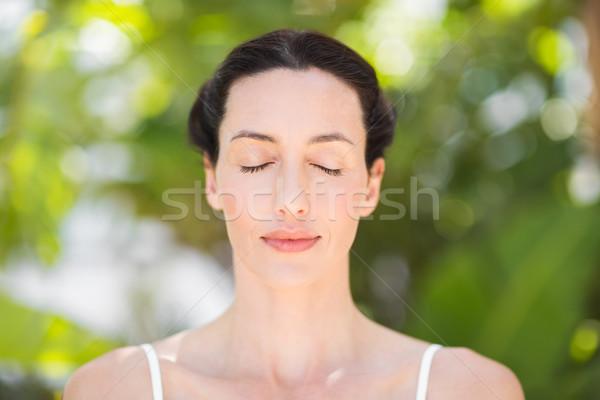 Portret kobieta medytacji pozycja biały niebo Zdjęcia stock © wavebreak_media