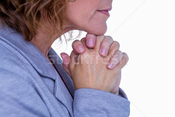 Bastante morena mujer rezando blanco manos Foto stock © wavebreak_media