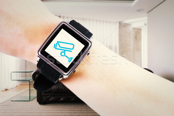 Composite image of woman using smartwatch  Stock photo © wavebreak_media