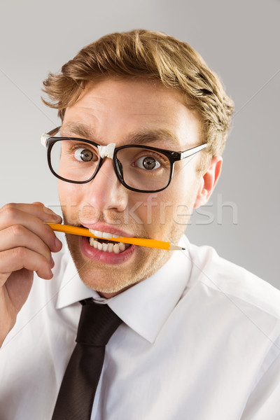 Geeky businessman biting a pencil Stock photo © wavebreak_media