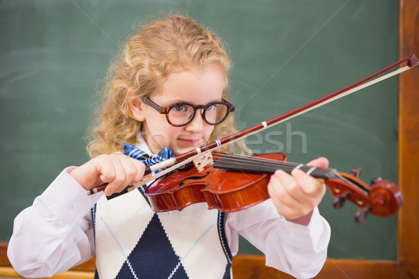 Stock photo: Cute pupil playing the violin