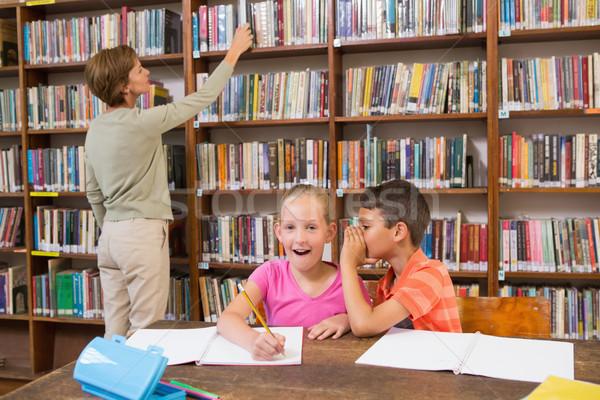 Cute pupils speaking at library  Stock photo © wavebreak_media
