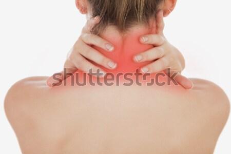 Mujer atractiva sufrimiento dolor de cuello blanco femenino bastante Foto stock © wavebreak_media