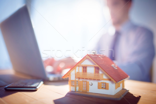 агент по продаже недвижимости используя ноутбук столе выстрел студию компьютер Сток-фото © wavebreak_media
