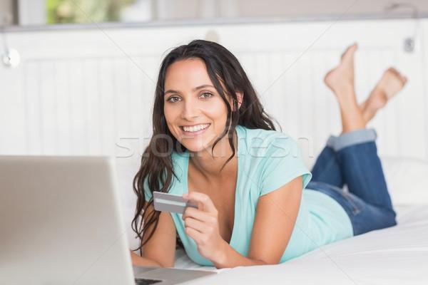Happy brunette shopping online with laptop Stock photo © wavebreak_media
