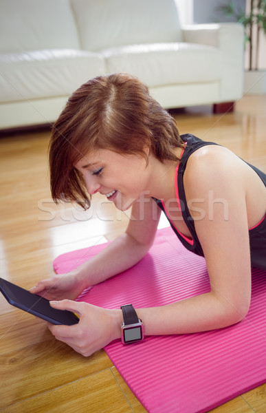 Fit woman using tablet pc on mat  Stock photo © wavebreak_media