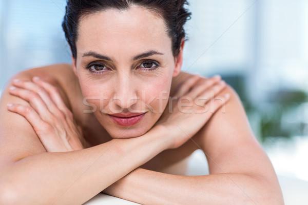 Smiling brunette relaxing on massage table Stock photo © wavebreak_media