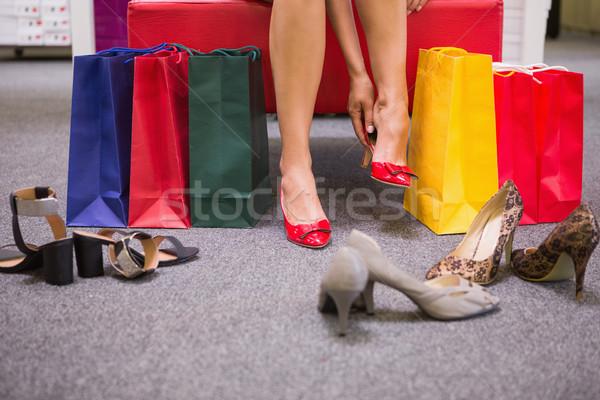 女性 座って ショッピングバッグ 靴 靴 ショップ ストックフォト © wavebreak_media