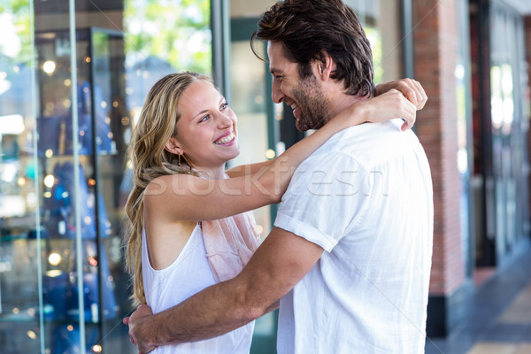 Smiling couple embracing and looking at each other Stock photo © wavebreak_media