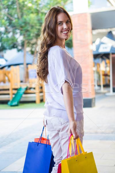 Pretty woman shopping at the mall Stock photo © wavebreak_media