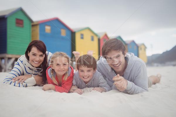 Portré mosolyog család homok tengerpart lány Stock fotó © wavebreak_media