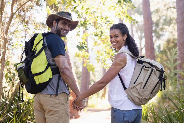 Vue arrière portrait couple mains tenant forêt jeunes Photo stock © wavebreak_media