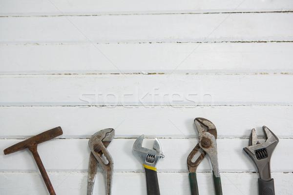 Vue menuiserie outils table blanche table en bois Photo stock © wavebreak_media