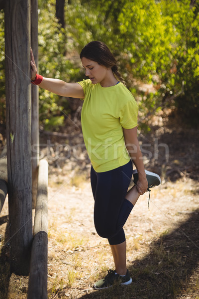 Beautiful woman performing stretching exercising during obstacle course Stock photo © wavebreak_media