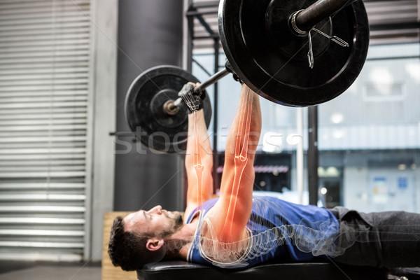 Stock photo: Male athlete exercising at gym