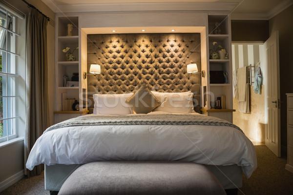 Interior of illuminated bedroom Stock photo © wavebreak_media