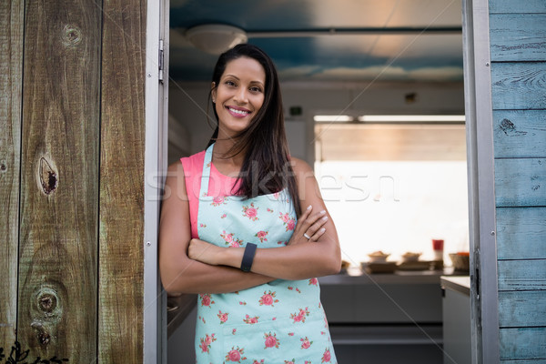 Portrait of happy waitress standing with arms crossed Stock photo © wavebreak_media