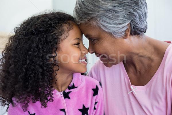 Mosolyog leányunoka nagymama ül szemtől szembe hálószoba Stock fotó © wavebreak_media