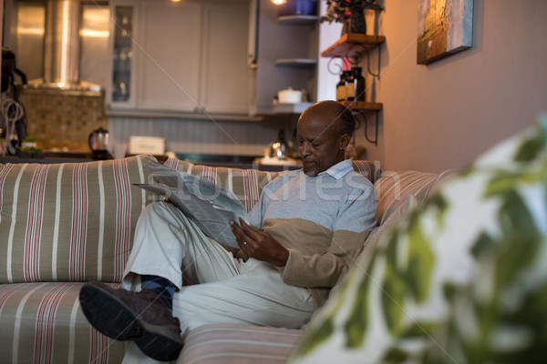 Senior man reading newspaper at home Stock photo © wavebreak_media