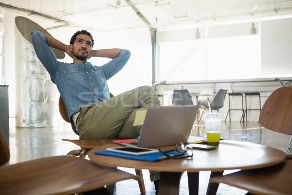 Man relaxing on chair in office Stock photo © wavebreak_media