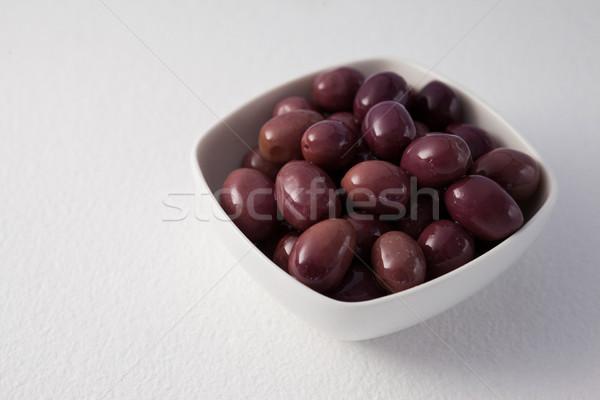 коричневый оливками контейнера белый деревянный стол Сток-фото © wavebreak_media