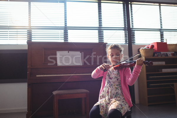 Schoolgirl rehearsing violin Stock photo © wavebreak_media